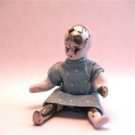 Broken girl.-Porcelain, pewter and Textile.